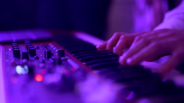 hands of men play on the synth. - synthesizer stock videos & royalty-free footage