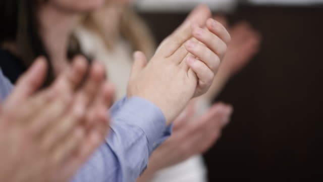 hands of people sitting down and applauding - applaudire video stock e b–roll