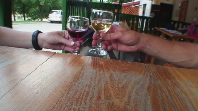 CU Hands of people toasting with red and white wine, Egar, Hungary