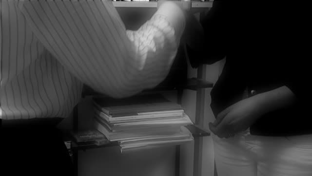 hands of 'schoolboy' receiving school documents - bekommen stock-videos und b-roll-filmmaterial