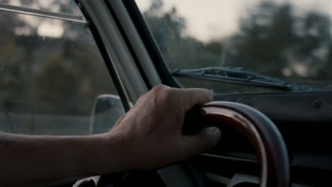 hands of senior man on steering wheel driving - driver stock videos & royalty-free footage