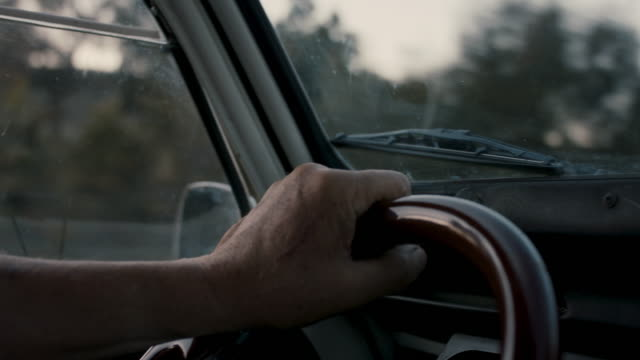 hands of senior man on steering wheel driving - lenkrad stock-videos und b-roll-filmmaterial