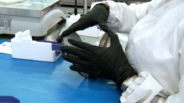 Cu Hands Of Solar Plant Employee Wearing Clean Room Protective