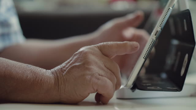 hands of the old woman and electronic tablet. - using digital tablet stock videos & royalty-free footage