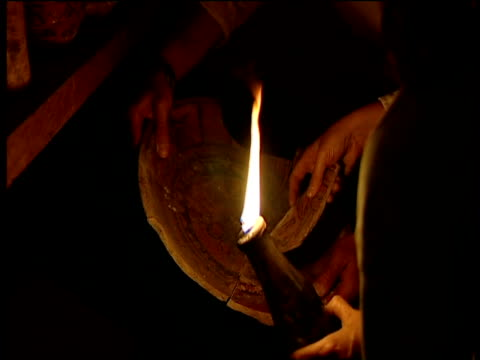 hands of three archaeologists assemble pieces of ancient mayan ceramics under torch light guatemala - latin american civilizations stock videos and b-roll footage