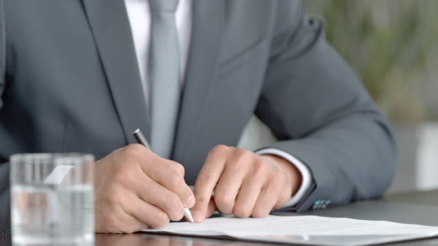 hands of two businessmen signing a contract in the conference room - file stock videos & royalty-free footage