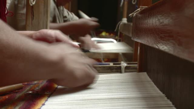 cu hands of two men weaving in workshop / oaxaca, mexico - weaving stock videos & royalty-free footage