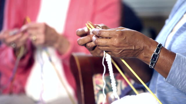 hands of two senior women knitting - craft stock videos & royalty-free footage