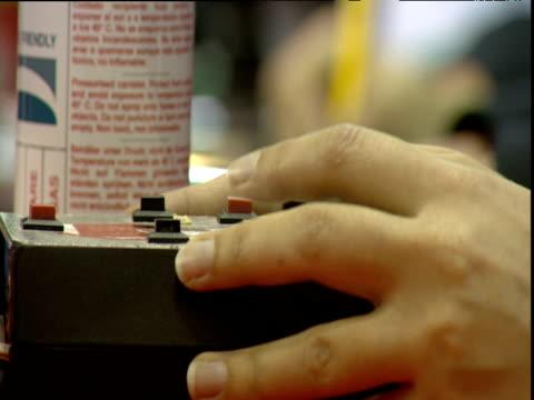 hands on buttons updating electronic score card as results read out london towers england - människofinger bildbanksvideor och videomaterial från bakom kulisserna