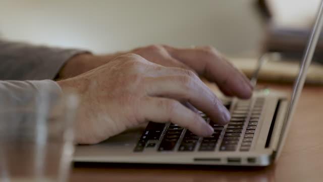 vídeos y material grabado en eventos de stock de hands on laptop keyboard - colour image