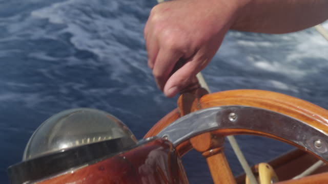 cu hands on wheel steering sailing yacht. - sailing boat stock videos & royalty-free footage