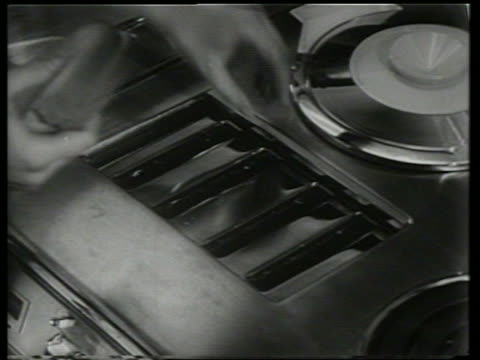 """b/w hands open slot and put bread in toaster on stove / """"kitchen of tomorrow"""" / sound - toaster appliance stock videos & royalty-free footage"""