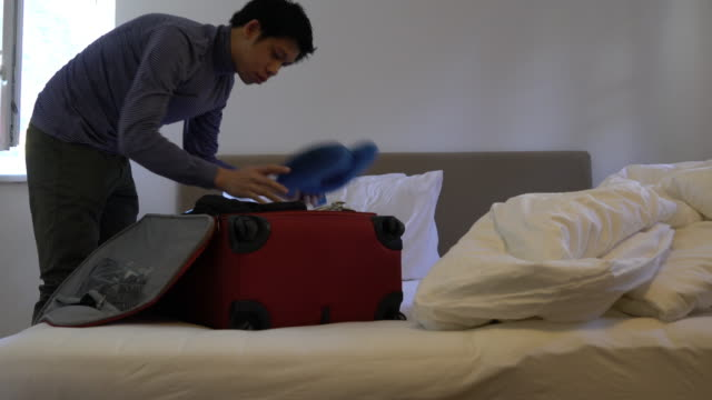 Hands Packing Clothes Luggage
