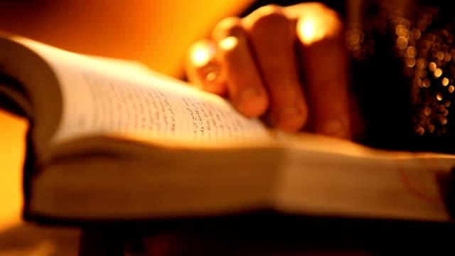 CU Hands paging through Arabic bible/ Cairo/ Egypt