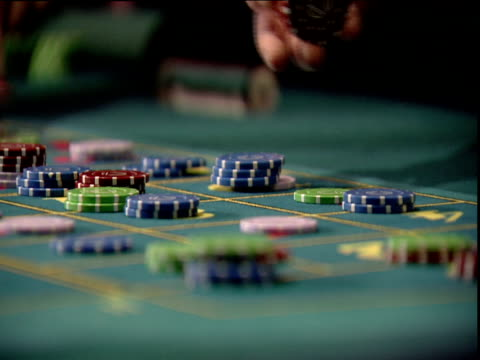 hands place coloured gambling chips on green baize table - casino winner stock videos & royalty-free footage
