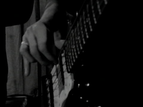hands play an electric bass guitar - bass guitar stock videos & royalty-free footage