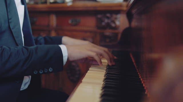 hands playing the white piano - tuxedo stock videos & royalty-free footage