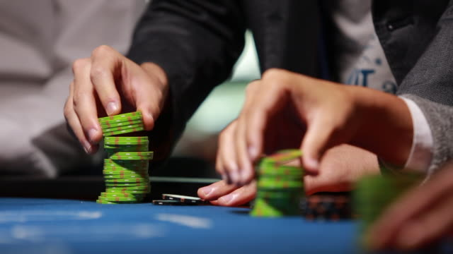 hands playing with chips on casino table - gambling chip stock videos & royalty-free footage