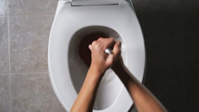 hands plunging a toilet - toilet stock videos and b-roll footage