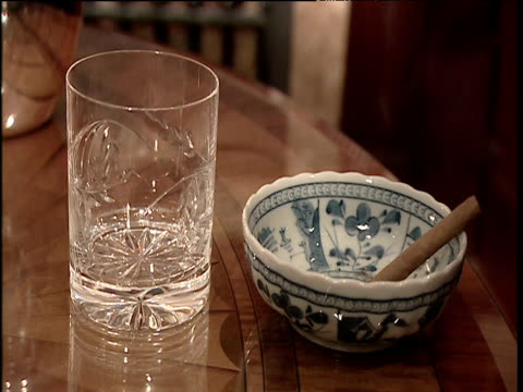 hands pour whiskey into glass and pick up cigar from ash tray - scotch whiskey stock videos and b-roll footage