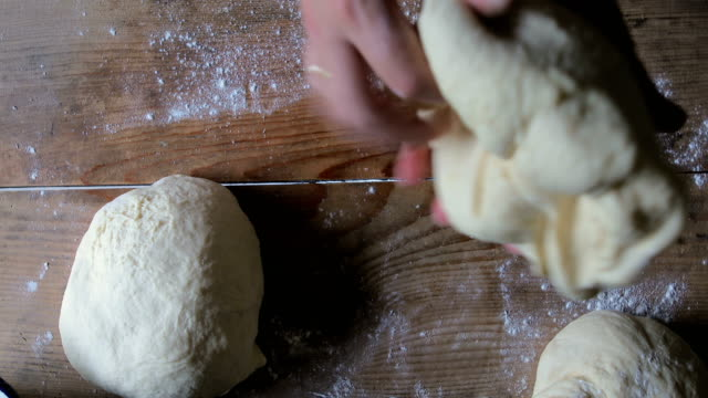 hands preparing bread dough on wooden table - sifting stock videos and b-roll footage