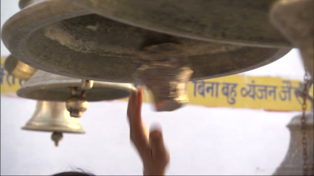 hands ring hanging bells in temple, bateshwar available in hd. - bell stock videos & royalty-free footage
