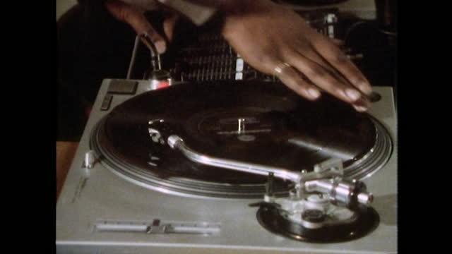 cu dj hands scratching vinyl record on turntable; 1989 - one man only stock videos & royalty-free footage