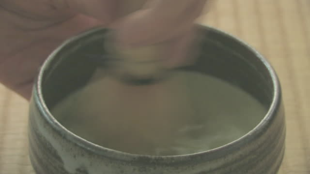 hands serving japanese green tea - unknown gender stock videos & royalty-free footage