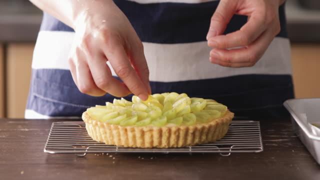 hands serving muscat on tart dough. - tart dessert stock videos & royalty-free footage