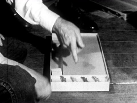 "1950 hands setting up ""uncle wiggily game"" board game on floor / usa / audio - toy stock videos & royalty-free footage"