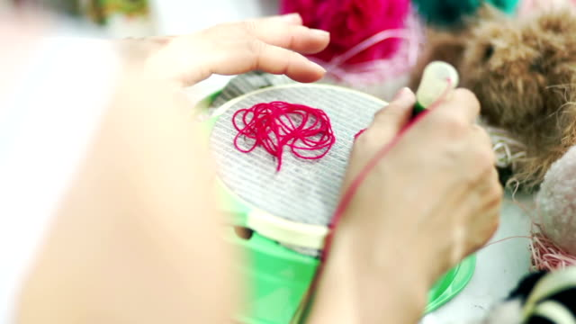 hands sewing embroidery handcraft on the hoop. - embroidery stock videos & royalty-free footage