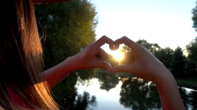 hands shaping a heart symbol - wellbeing stock videos & royalty-free footage
