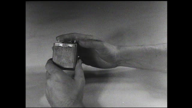 hands shuffle through file cards one by one; hands circle items on pile of forms; woman shuffles through pile of forms; hands remove inner workings... - 1940 1949 video stock e b–roll