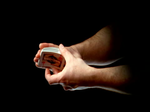 hands shuffling playing cards - shuffling stock videos and b-roll footage