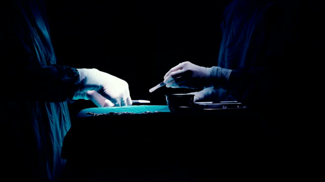 hands specialized team performing surgery close up - latex glove stock videos & royalty-free footage