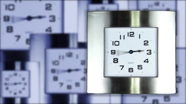 hands spin on a metallic office clock over composited other clocks. - medium group of objects stock videos & royalty-free footage