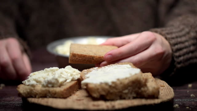 hands spreading cottage cheese on toast - loaf of bread stock videos & royalty-free footage