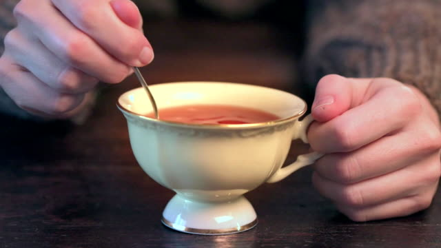 hands stiring tea - affectionate stock videos & royalty-free footage