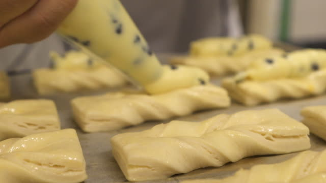 hands stuffing pastry cream - icing stock videos and b-roll footage