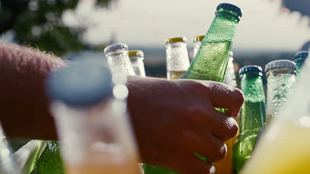 slo mo hands taking bottles of cold drink from a cooler - refreshment stock videos & royalty-free footage
