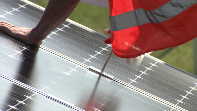 ms tu hands tightening instillation fittings on solar panel - installing stock videos & royalty-free footage