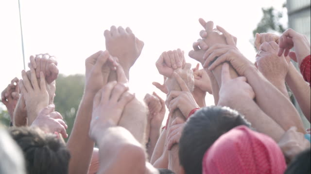 Hands touching at Castellers human pyramid foundation