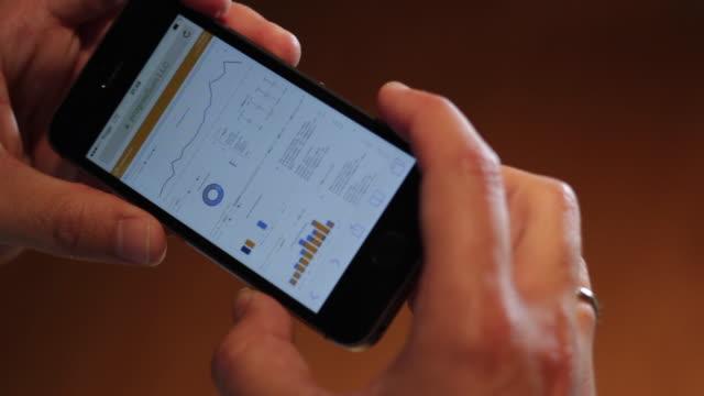 hands touching smartphone - 2010年代点の映像素材/bロール