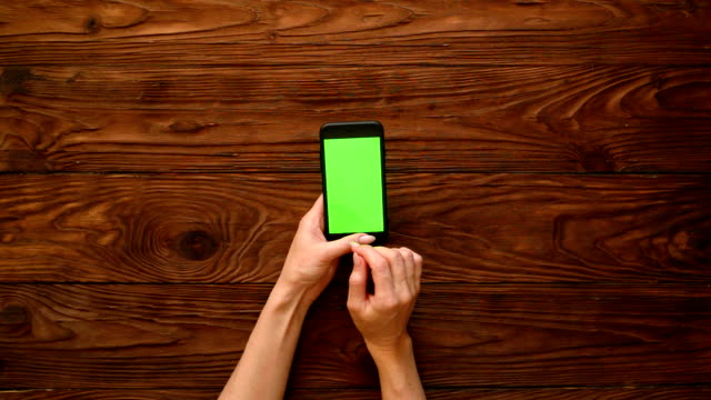 hands touching the screen of mobile phone - flat lay stock videos & royalty-free footage