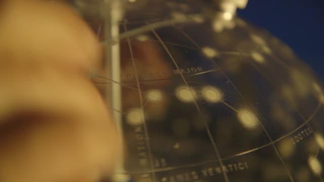 cu hands turn a celestial globe - galaxy stock videos & royalty-free footage