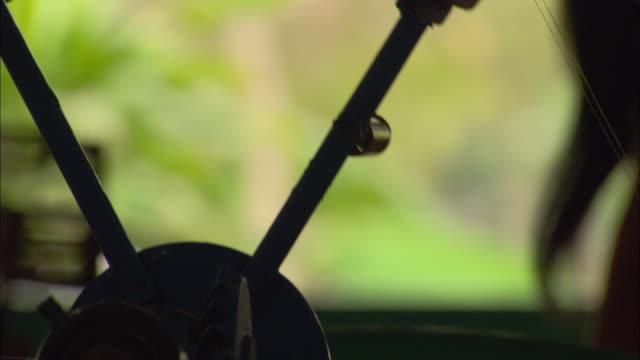 hands turn a spoked wheel. - speichen stock-videos und b-roll-filmmaterial