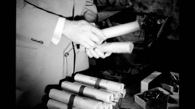 hands tying bundles of dynamite sticks. on january 01, 1940 - explosive stock videos & royalty-free footage