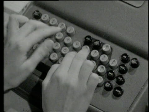 hands type on a punch card machine - punch card stock videos & royalty-free footage