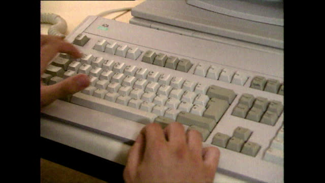 stockvideo's en b-roll-footage met hands type on old computer keyboard with monitor; 1989 - 1980 1989