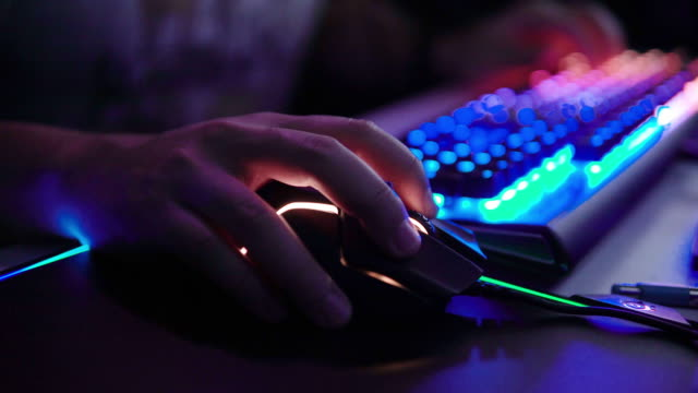 hands typing on led computer keyboard. - leisure games stock videos & royalty-free footage